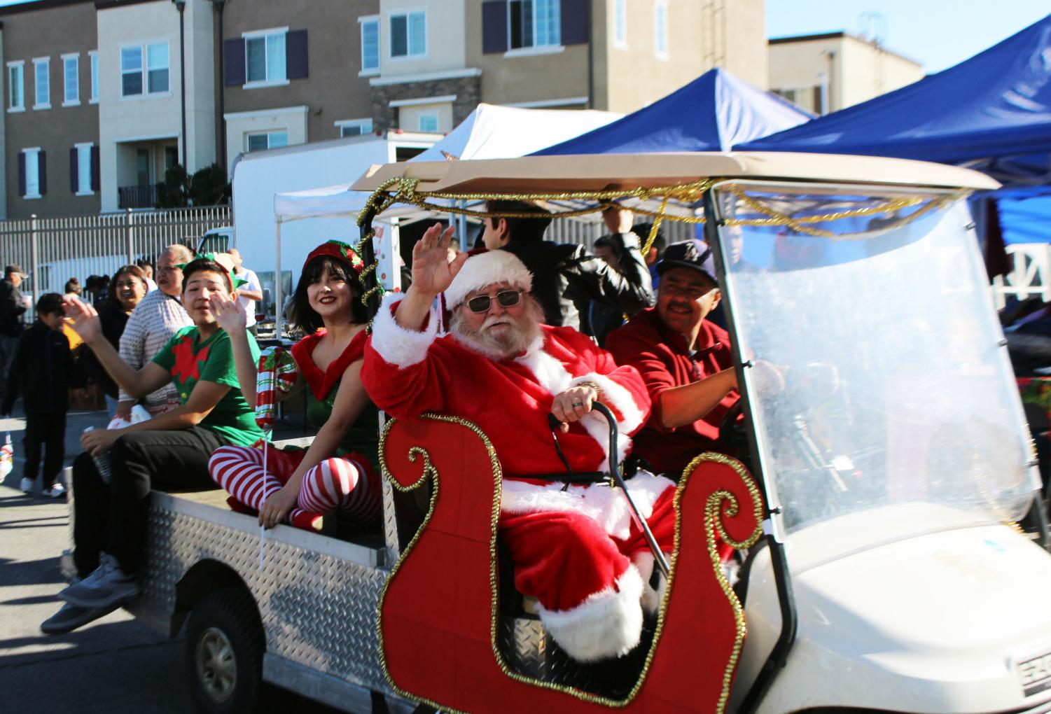 Santa Claus waves at excited parents and students at PTSA Swap Meet.