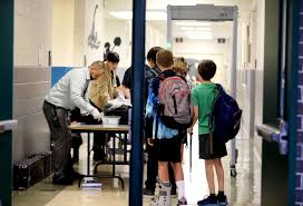 Students at Waccamaw Middle School pass through metal detectors as they arrive at school in Pawleys Island.