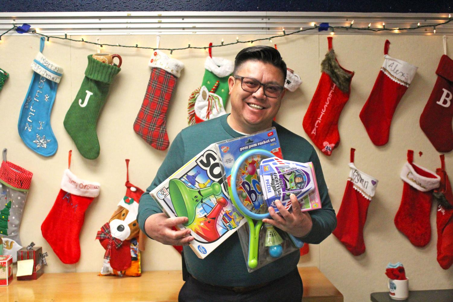 Dr. Morales displays some toys that some kids will be taking home.