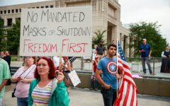 INDIANAPOLIS, INDIANA, UNITED STATES - 2020/07/19: A protester holds a placard saying No Mandated Masks or Shutdown Freedom First during the We Will Not Comply anti mask rally. People protest against both the Indianapolis mayor Joe Hogsetts mask order and Indiana governor Eric Holcombs extension of the state shutdown. The U.S. Department of Health recorded a total of 3,898,550 infections, 143,289 death and 1,802,338 recovered since the beginning of the Coronavirus (Covid-19) outbreak. (Photo by Jeremy Hogan/SOPA Images/LightRocket via Getty Images)